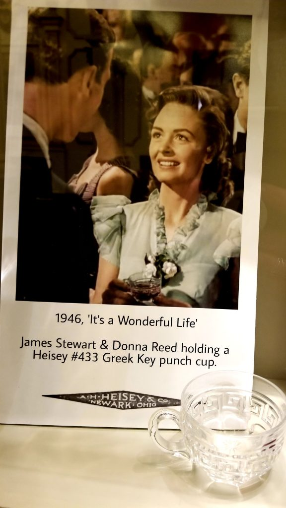 """My Town's favorite Small Town Movie """"It's A Wonderful Life"""" displaying Heisey Glass in the famous scene"""